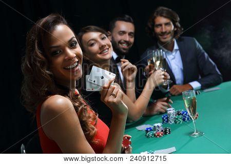 adult group celebrating friend winning blackjack