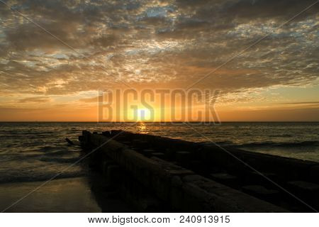 An Old Concrete Pier At Sunset On A Beach In Florida.  Siesta Key, Fl, Usa.
