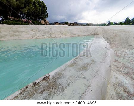 Natural Travertine Pools And Terraces In Pamukkale Closeup In Springtime, May 2018, Turkey.