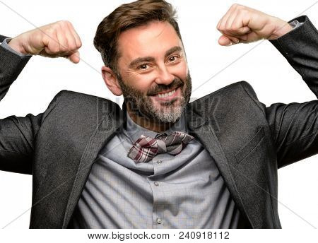 Middle age man, with beard and bow tie showing biceps expressing strength and gym concept, healthy life its good isolated over white background