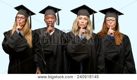 Education concept, university graduate woman and man group with index finger on lips, ask to be quiet. Silence and secret concept
