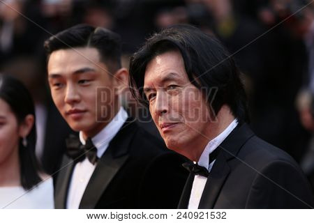 Lee Jong-Dong, actor Steven Yeun attend the screening of 'Burning' during the 71st  Cannes Film Festival at Palais des Festivals on May 16, 2018 in Cannes, France.
