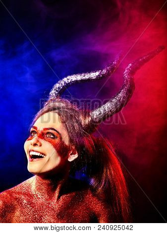Mad satan woman on black magic ritual of in hell . Witch reincarnation mythical creature on Sabbath. Devil absorbing soul on Halloween. Taurus astrology. Astral entities.
