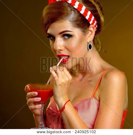 Retro woman with music vinyl record. Pin up girl drink martini cocktail. Girl pin-up retro style wearing red dress on dark background. Stunning dress style. Sexy girl in bar.