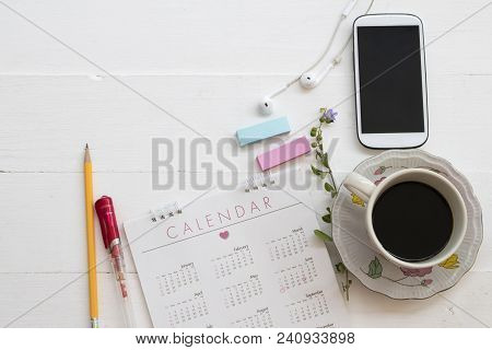Hot Coffee With Mobile Phone And Calendar Planner For Business At Office Deak