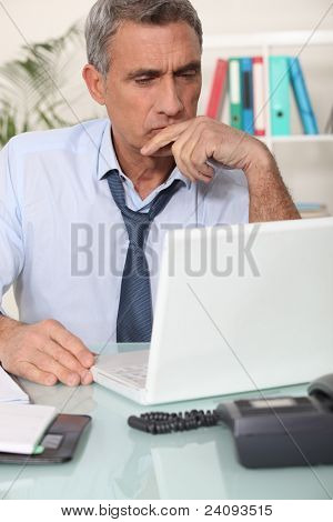 Grouchy man reading an email