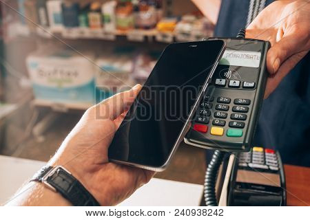 Wireless Payment For Buying A Smartphone In The Store Through The Payment Terminal