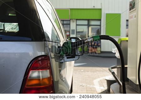 The Process Of Refueling The Car With Gasoline. The Hose Is Inserted Into The Gas Tank.