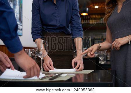 Cropped Image Of Restaurant Owner Explaining Work To Employees