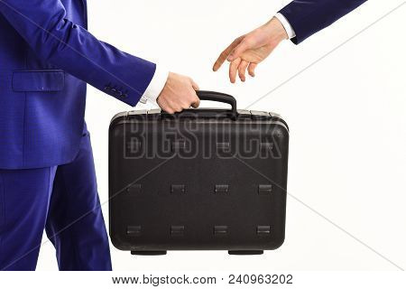 Male Hand Carry Briefcase For Exchange Or Offering Bribe. Handover Of Case In Hands Of Business Part
