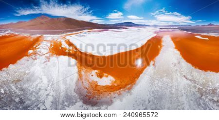 Aerial panorama of the Laguna Colorada located in the south of Bolivia at Eduardo Abaroa Andean Fauna National Reserve.