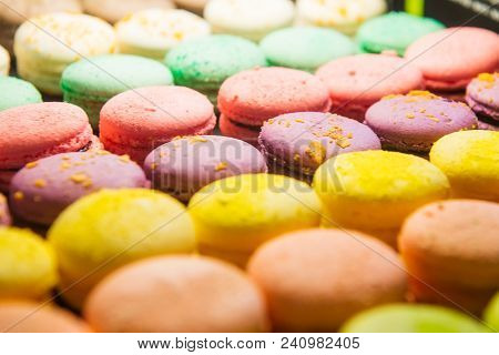 Assortment Of Colorful Macarons For Sale In Shop. Rows Of Macaroons In Candy Shop, Storefront With S