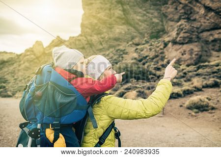 Super Mom With Baby Boy Carried In Backpack. Hiking Adventure Mother With Child On Family Trip In Mo