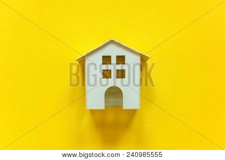 Simply Flat Lay Design With Miniature White Toy House On Yellow Colorful Paper Trendy Background. Mo