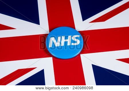 London, Uk - April 27th 2018: The National Health Service Symbol Over The Uk Flag, On 27th April 201