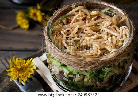 Salad From Sprouts Of Sprouted Soy And Dandelion Leaves In A Jar
