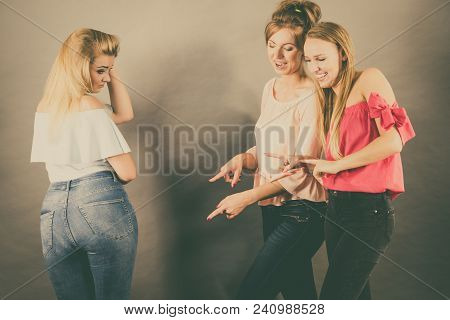 Woman Being Bullied By Two Female Friends Gossiping About Her Body Shape. Friendship Rivaly And Envy