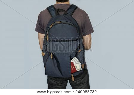 Man Tourist Backpacker Holding Passport Full Of Money. Young Guy Hiker Backpacking. Summer Vacation