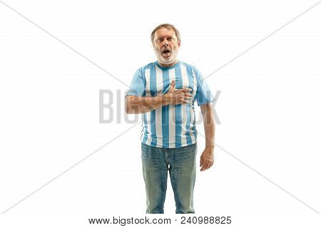 The Argentinean Fan Celebrating On White Background. The Senior Man In Soccer Football Uniform Singi