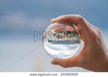 Popular Summer Resort Town Budva On The Adriatic Coast In Montenegro Reflected In A Transparent Roun