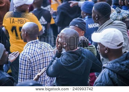 Cape Town, South Africa, 12 May 2018 - Diverse South African Football Supporters Disagreeing With A