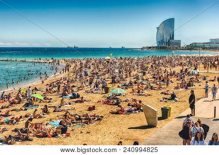 Barcelona - August 10: People Enjoying A Sunny Day On La Barceloneta Beach, Barcelona, Catalonia, Sp