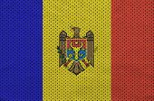 Moldova flag printed on a polyester nylon sportswear mesh fabric with some folds poster