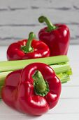 Colored foodstuffs red pepper green fresh celery. poster