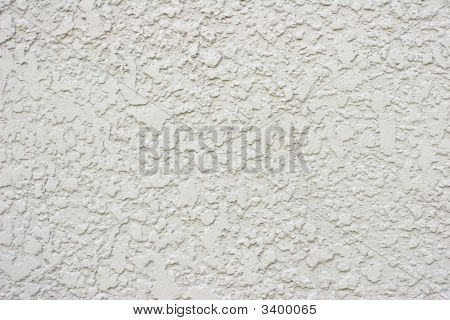 Textured White Or Grey Stucco Wall With Small Crack