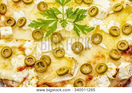 Italian Focaccia With Three Types Of Cheese, Green Olives And Parsley