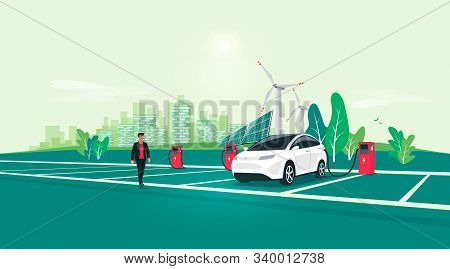 Electric Car Charging On Charger Station On Rest Area Road Highway To City. Battery Vehicle Standing