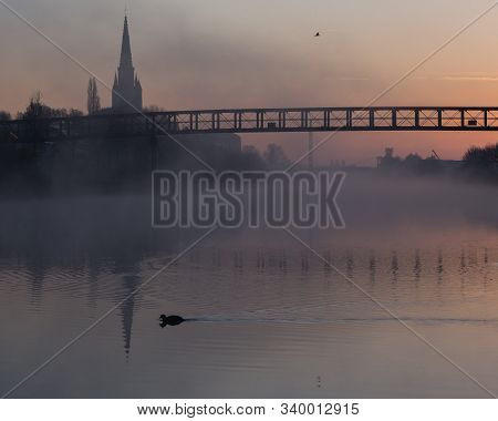 An Atmospheric Sunrise On The Banks Of The Leie In Wervik, Belgium.