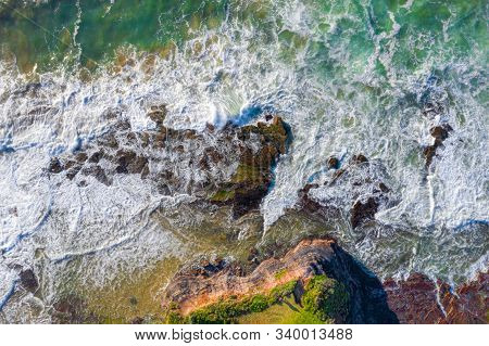 Tidal Flows Over Coastal Rocks And Eroded Chasms Of A High Tide. Aerial Views Background Nature Imag