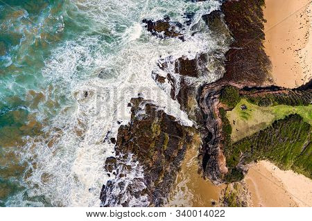 Views Over The Steep Headland To The Rocky Shores And Beach Below.location: Austinmer Australia