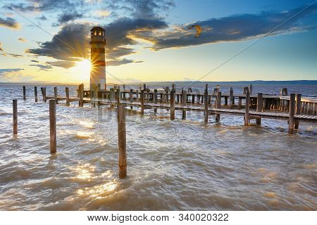 Popular Lighthouse At Lake Neusiedl See During Sunset. Podersdorf At The Lake Is Town In District Of