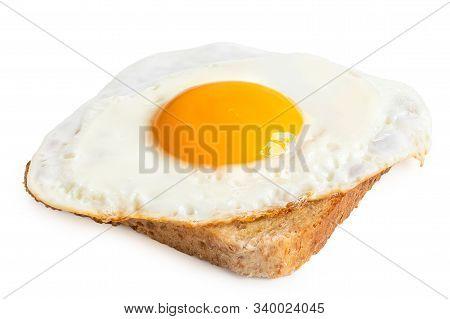 Single Fried Egg With Crispy Edges On Wholewheat Toast Isolated On White.