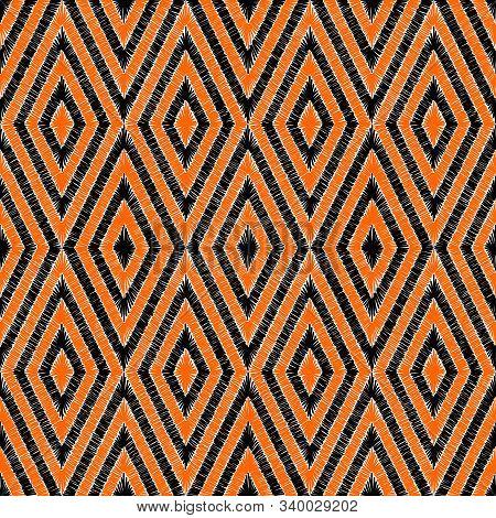 Embroidered Seamless Pattern. Bohemian Style Carpet Ornament. Hand-drawn Geometric Print.
