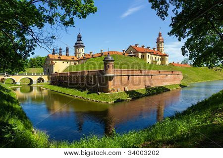 Medieval castle and moat around it in Nesvizh, Belarus. poster