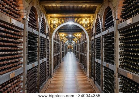 Chisinau, Moldova - June 24, 2019: Wine bottles stacked up in underground wine cellar in Chisinau, Moldova
