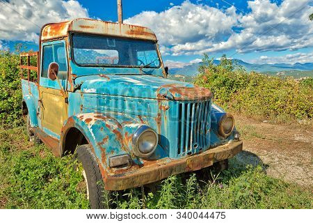 Nafplio, Peloponnese, Greece - August 29, 2015: A Rusty Wreck Of Pick-up Car Abandoned In The Countr