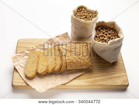 Famous Javanese Cuisine Food. Tempe Or Tempeh With Soybeans On Wooden Board, Isolated On White Backg