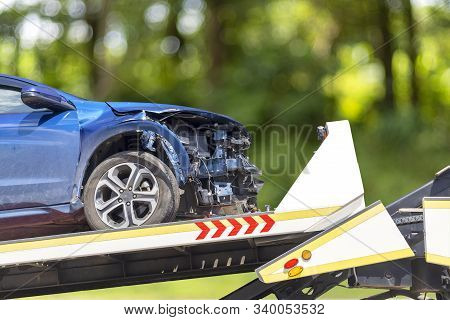 Accident Car Slide On Truck For Move. Blue Car Have Damage By Accident On Road Take With Slide Truck