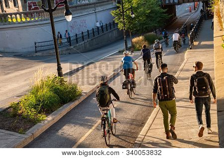 Montreal, Canada - 19 September 2019: People Riding Bikes On A Cycle Path, On Saint Laurent Boulevar