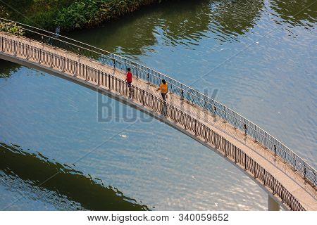 Singapore-12 Oct 2019: People Walking On Punggol Waterway Landscape Bridge View