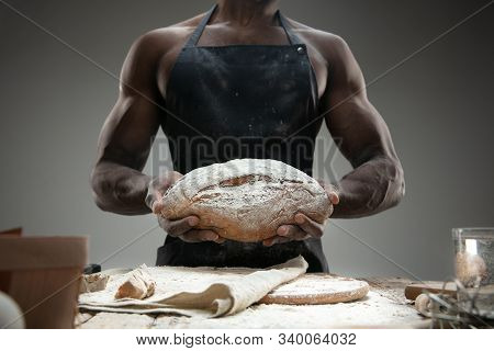 Close Up Of African-american Man Cooks Fresh Cereal, Bread, Bran On Wooden Table. Tasty Eating, Nutr