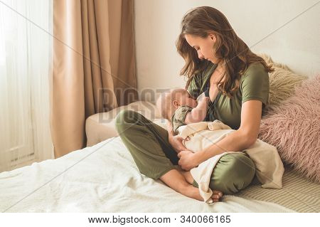 The Concept Of Breastfeeding. Portrait Of Mom And Breastfeeding Baby.