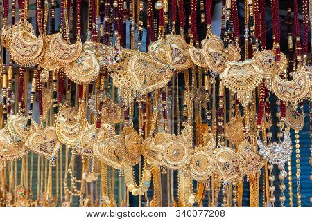 Auspicious Gold Plated Neck Pieces Are Hanging For Sale To Indian Bengali Women, At Kalighat, Kolkat