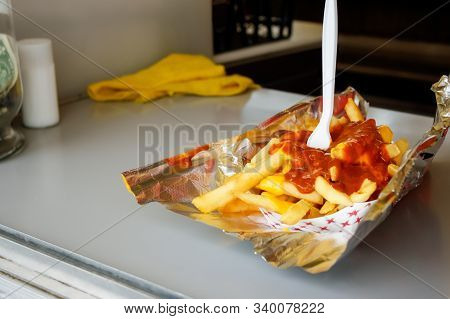 Messy Festival Fare, Chili Cheese French Fries, Is Served With Aluminum Foil Under And A Plastic For