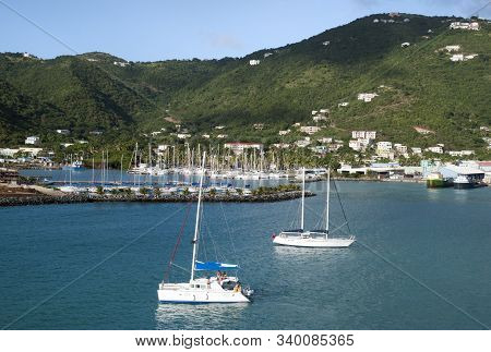 The Catamaran Passing By In Road Town Baughers Bay On Tortola Island (british Virgin Islands).