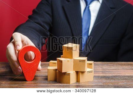 A Businessman Sets A Destination For Delivery Of Goods. Distribution, Freight Transportation Shipmen
